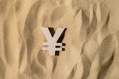 Yen Sign On the Sand royalty free stock photo