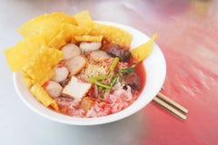 Yen taa fo egg noodle with crispy dumplings Stock Image