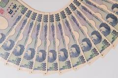 Yenes japoneses, 1000 yenes en el fondo blanco, banco japonés de los yenes de la moneda fotos de archivo libres de regalías