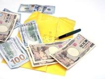 Yenes japoneses y dólares de EE. UU. imagen de archivo libre de regalías
