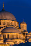 Yeni Cami. The New Mosque (Yeni Cami) lit up in late evening in Istanbul, Turkey Stock Photos