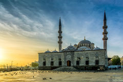 The Yeni Cami. The New Mosque (Yeni Cami) at sunrise, twilight, in Eminonu district of Istanbul, Turkey royalty free stock photography