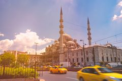 Yeni Cami mosque in istanbul, Turkey. Yeni Cami Ottoman imperial mosque located in the Eminönü quarter of Istanbul, Turkey. Sunset cloudy sky in background stock photos