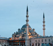 Yeni or New Mosque by Galata bridge in Istanbul. The Mosque of the Valide Sultan or New Mosque in the evening by the Galata Bridge stock image