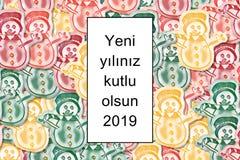 Yeni yılınız kutlu olsun 2019 card Happy New Year in turkish with colored snowman as a background stock illustration