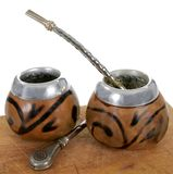 Yerba mate. Isolated two calabash with traditional argentinian drinking of mate Royalty Free Stock Image