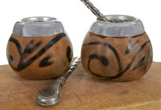 Yerba mate. Isolated two calabash with traditional argentinian drinking of mate Royalty Free Stock Photography