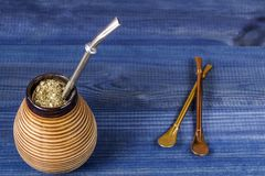 Traditional yerba mate. Yerba mate in calabash with bombilla royalty free stock image