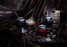Yerba mate and calabashes (artistic still life). Yerba mate and calabashes; method light painting photography Royalty Free Stock Photo