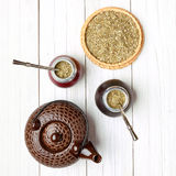Yerba mate and calabashes on a light wooden background stock photos