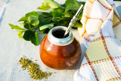 Yerba mate in gourd calabash with bombilla. Traditional Latin America herbal tea in mate calabash with special mate drinking straw bombilla stock photos