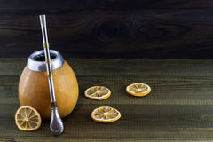 Yerba mate with gourd matero, bombilla and lemon slices Stock Photography