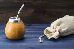 Yerba mate with gourd matero, bombilla and linen bag Royalty Free Stock Photography