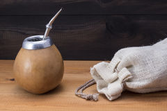 Yerba mate with gourd matero, bombilla and linen bag Stock Photography
