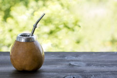 Yerba mate in gourd matero on woooden table Stock Photography