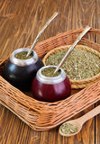Yerba mate and mate in calabash on a wicker tray Royalty Free Stock Image