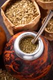 Yerba mate tea with calabash and bombilla. Traditional Argentinian drink Royalty Free Stock Images
