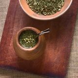 Yerba Mate Tea. South American yerba mate tea in a wooden mate cup with strainer called bombilla, photographed with natural light. Mate is the national infusion royalty free stock image