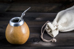 Yerba mate on wooden background Royalty Free Stock Photo
