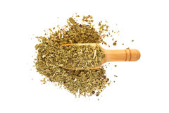Yerba mate with a wooden spoon royalty free stock image
