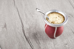 Yerba mate on wooden table Stock Photos