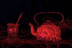 Yerba matte and hot water kettle and red laser beam Stock Photo