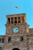 Yerevan. Armenia. Clock Tower and the national flag. Royalty Free Stock Images