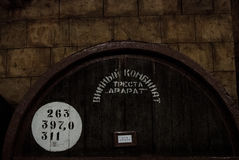 YEREVAN, ARMENIA - DECEMBER 30, 2016: Wooden barrel of aged wine at cellar of Brandy Factory Noy. Of Yerevan, Armenia Stock Photos