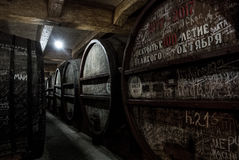 YEREVAN, ARMENIA - DECEMBER 30, 2016: Wooden barrels of aged wine at cellar of Brandy Factory Noy. Of Yerevan, Armenia Royalty Free Stock Photos