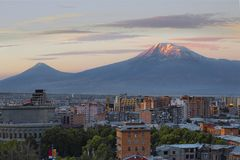 Yerevan, capital of Armenia at the sunrise with the two peaks of the Mount Ararat on the background. View over Yerevan and Ararat Mountains, Armenia Royalty Free Stock Photography