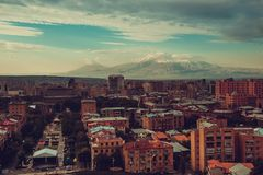 Yerevan cityscape. Travel to Armenia. Tourism industry. Impressive Mount Ararat background. Cloudy sky. Armenian architecture. Cit. Y tour. Urban landscape Royalty Free Stock Photos