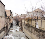 Yerevan suburb. Houses and small river Royalty Free Stock Photos