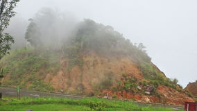 Yersin House Back Site against White Thick Mist in Mountains. Panorama of Yersin house back site with tropical plants in mountains against white thick mist stock video footage