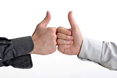 Yes. Two businessman show yes sign Royalty Free Stock Photo