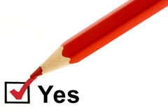 Yes. Check red pencil white background Stock Image