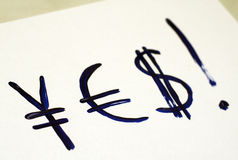 Yes!. I'll be rich! Symbols of currensy on paper Royalty Free Stock Photos