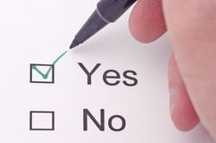 Yes. Someone indicating yes on a survey in green pen Royalty Free Stock Images