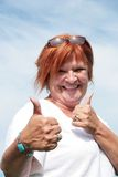 Yes!!. Mature woman with two thumbs up Royalty Free Stock Photography