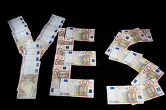 Yes. Word Yes written of 50-Euro bills on bl? background Royalty Free Stock Photography
