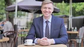 Yes, Accepting Businessman Sitting in Outdoor Cafe stock footage