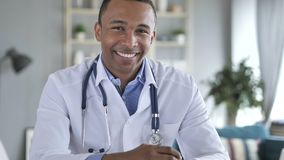 Yes, African-American Doctor Shaking Head to Allow Patient stock photography