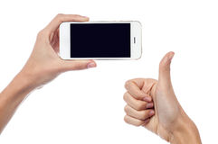 Yes! This is the best smartphone. Cropped image of woman hand holding new cellphone Stock Photo