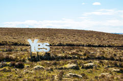 Yes in big white wooden letters with Scottish moorland in the background Royalty Free Stock Photos