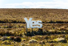 Yes in big white wooden letters with Scottish moorland in the background Stock Photo