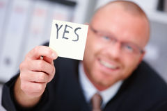YES - Businessman presenting copyspace Royalty Free Stock Image