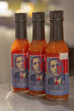 Yes we can Hot Sause bottles on display in Manhatt Stock Photos