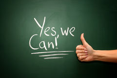 Yes we can written on blackboard stock photo