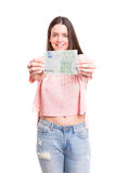 Yes! Extra cash!. Beautiful young woman showing some banknotes Stock Images