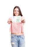 Yes! Extra cash!. Beautiful young woman showing some banknotes Stock Photography