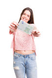 Yes! Extra cash!. Beautiful young woman showing some banknotes Royalty Free Stock Photography